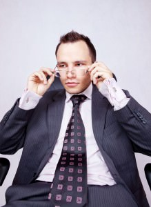 Young businessman with a pair of modern glasses